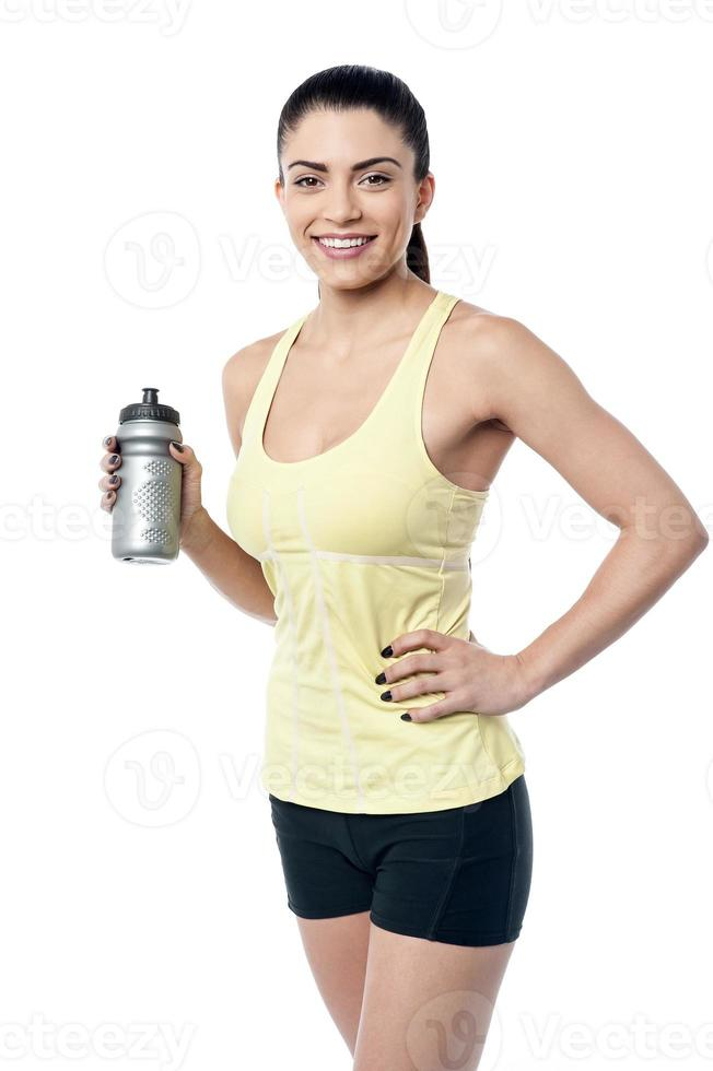 Woman drink water after workout. photo