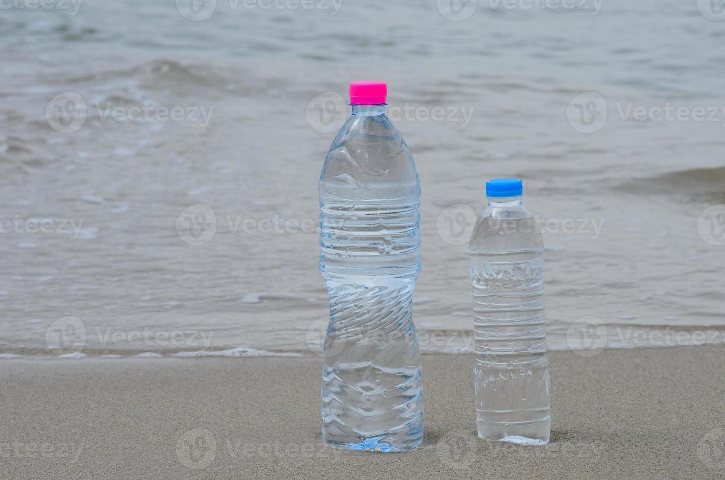 drinking water on the beach photo