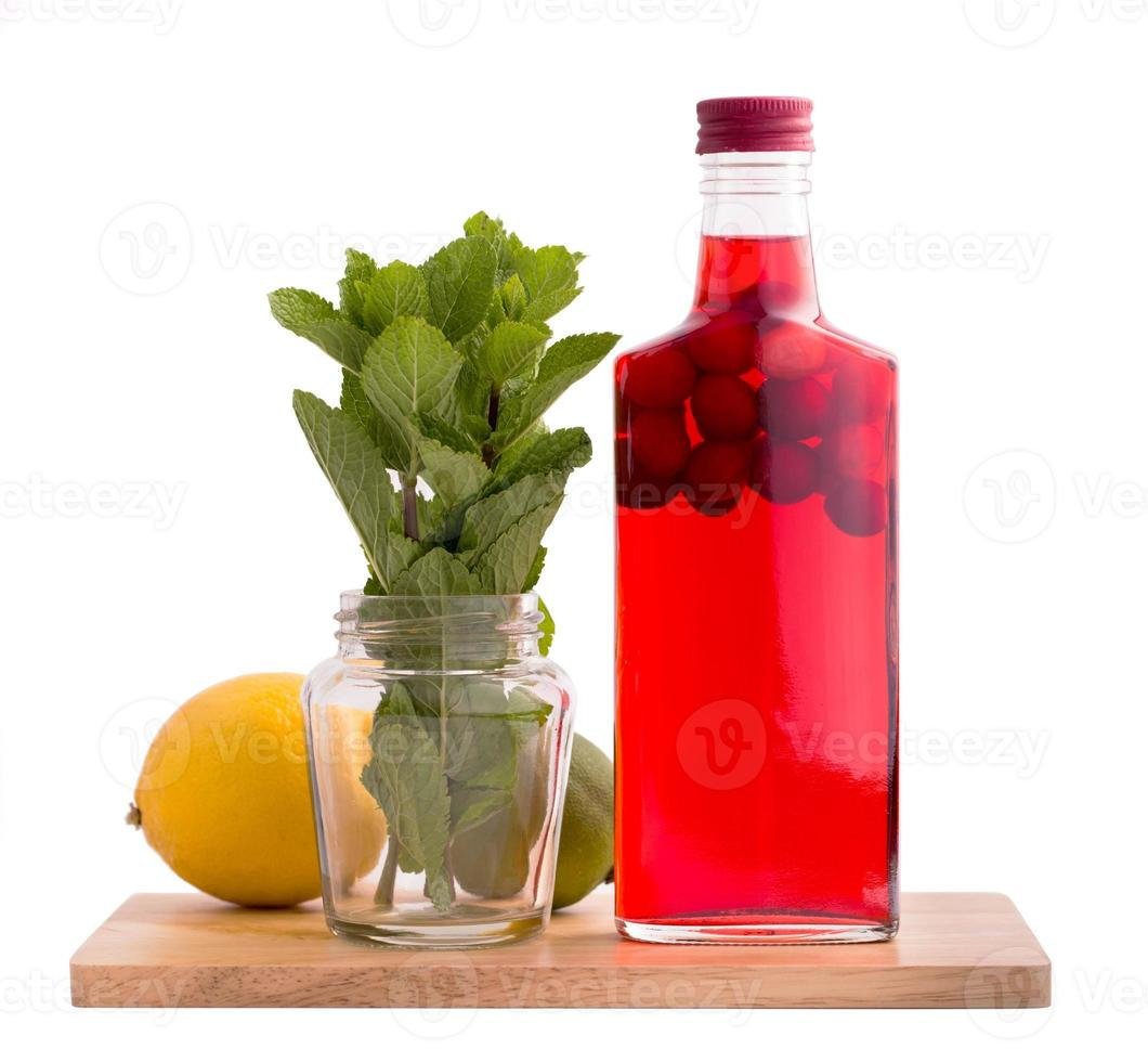 Bottle of cranberry drink isolated photo