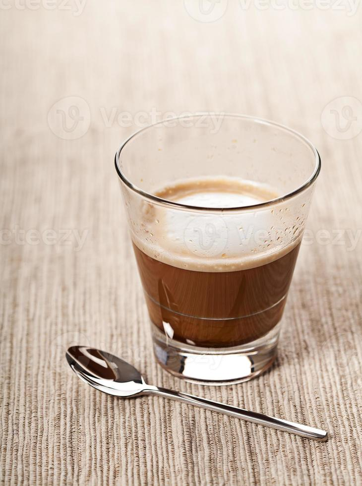 Cortado coffee drink in glass photo