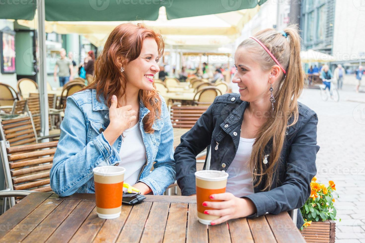 Teenage Girls Drinking at Bar photo