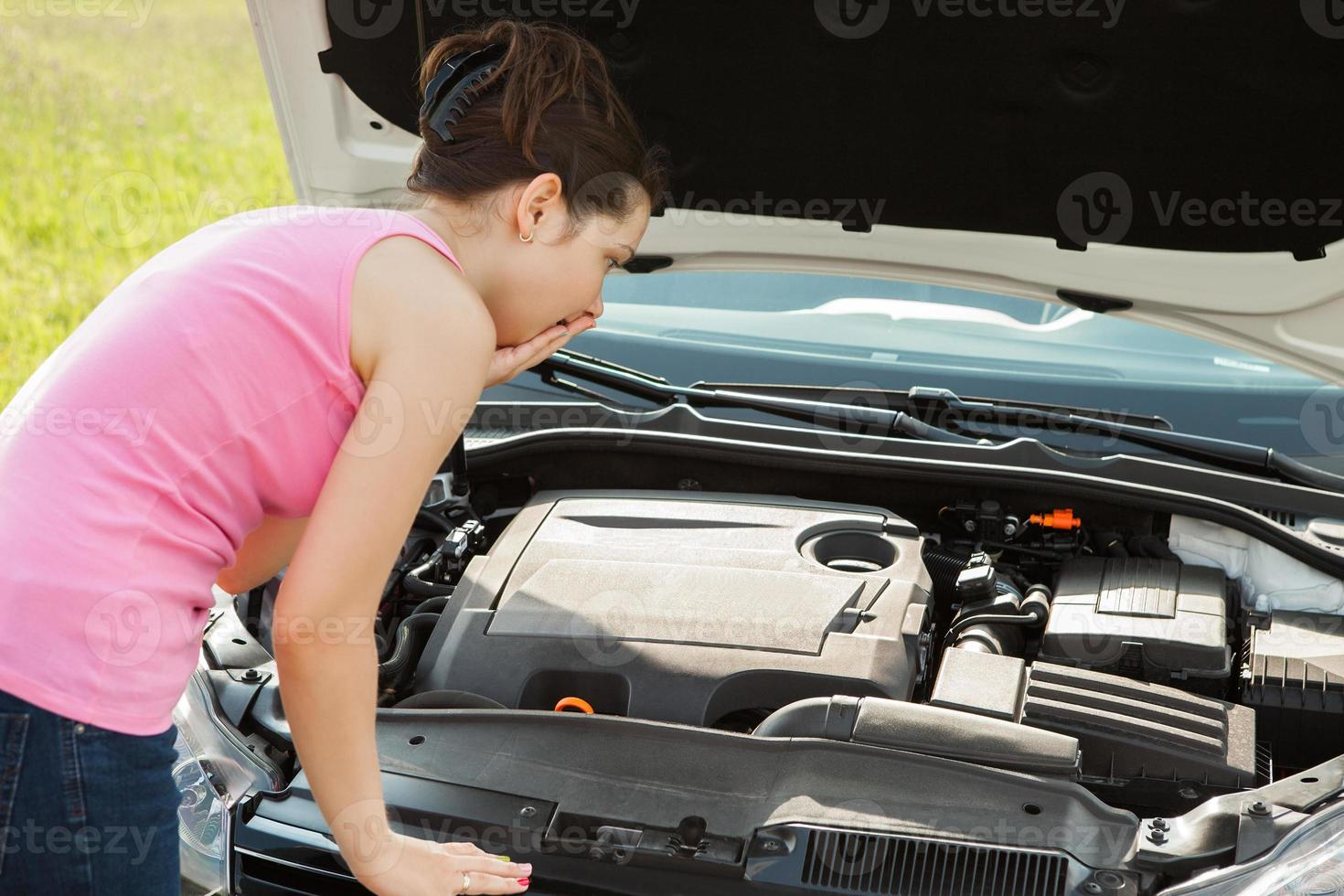 Woman Looking Under Hood Car photo