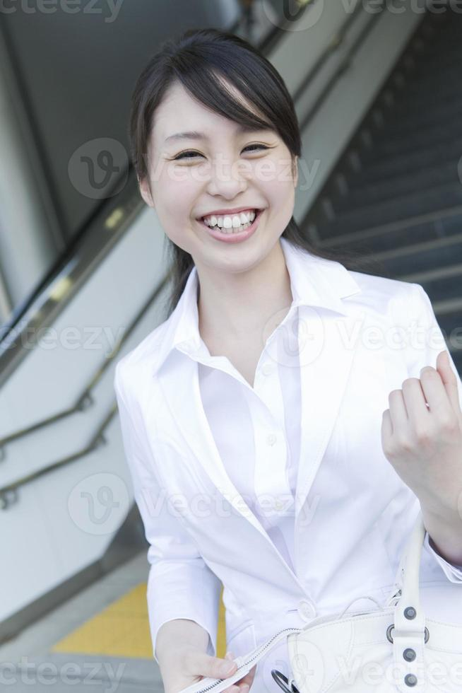 Young woman wearing white suit photo