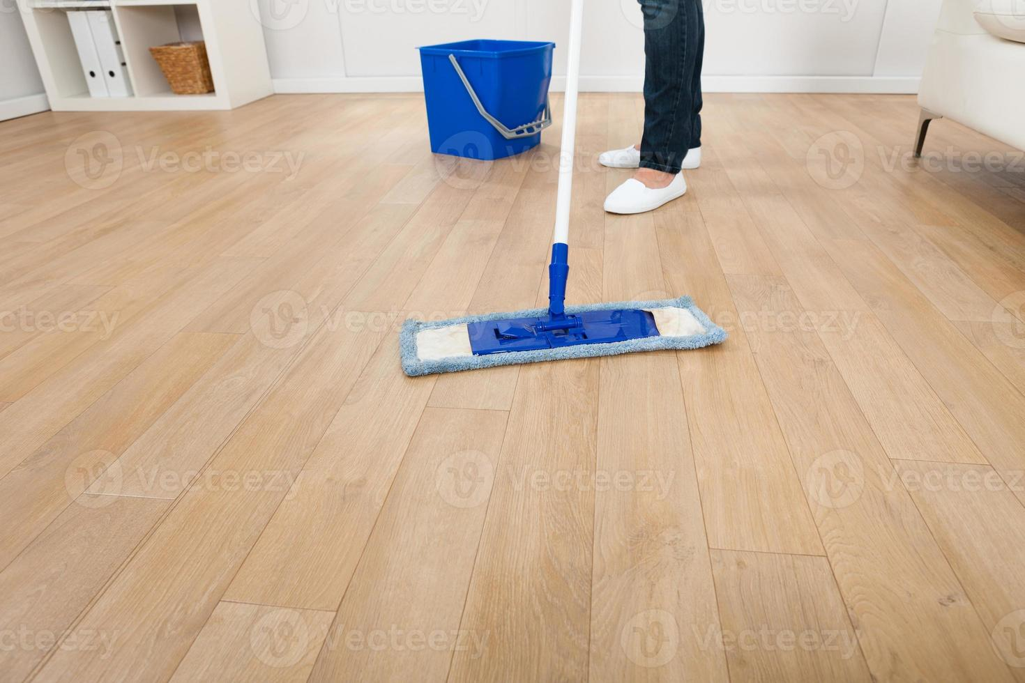 Woman Mopping Hardwood Floor At Home photo