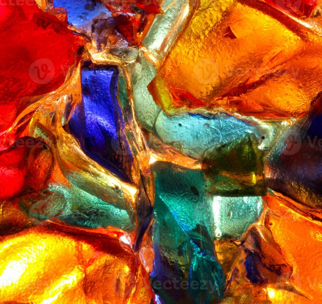 Closeup of back lit stained abstract glass pattern photo