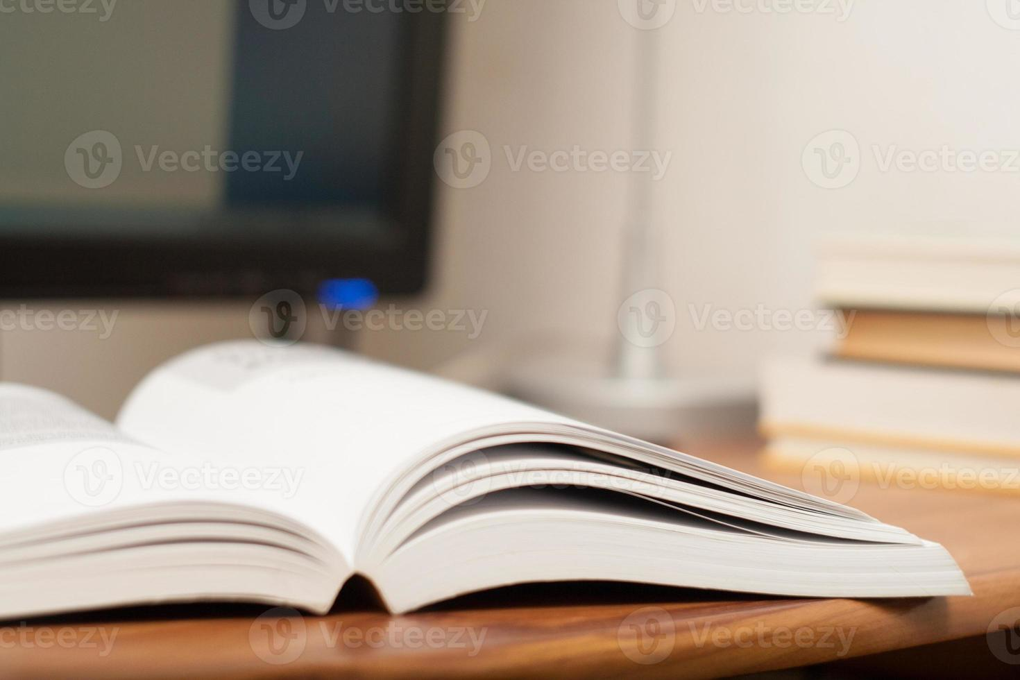 Open book on a work table photo