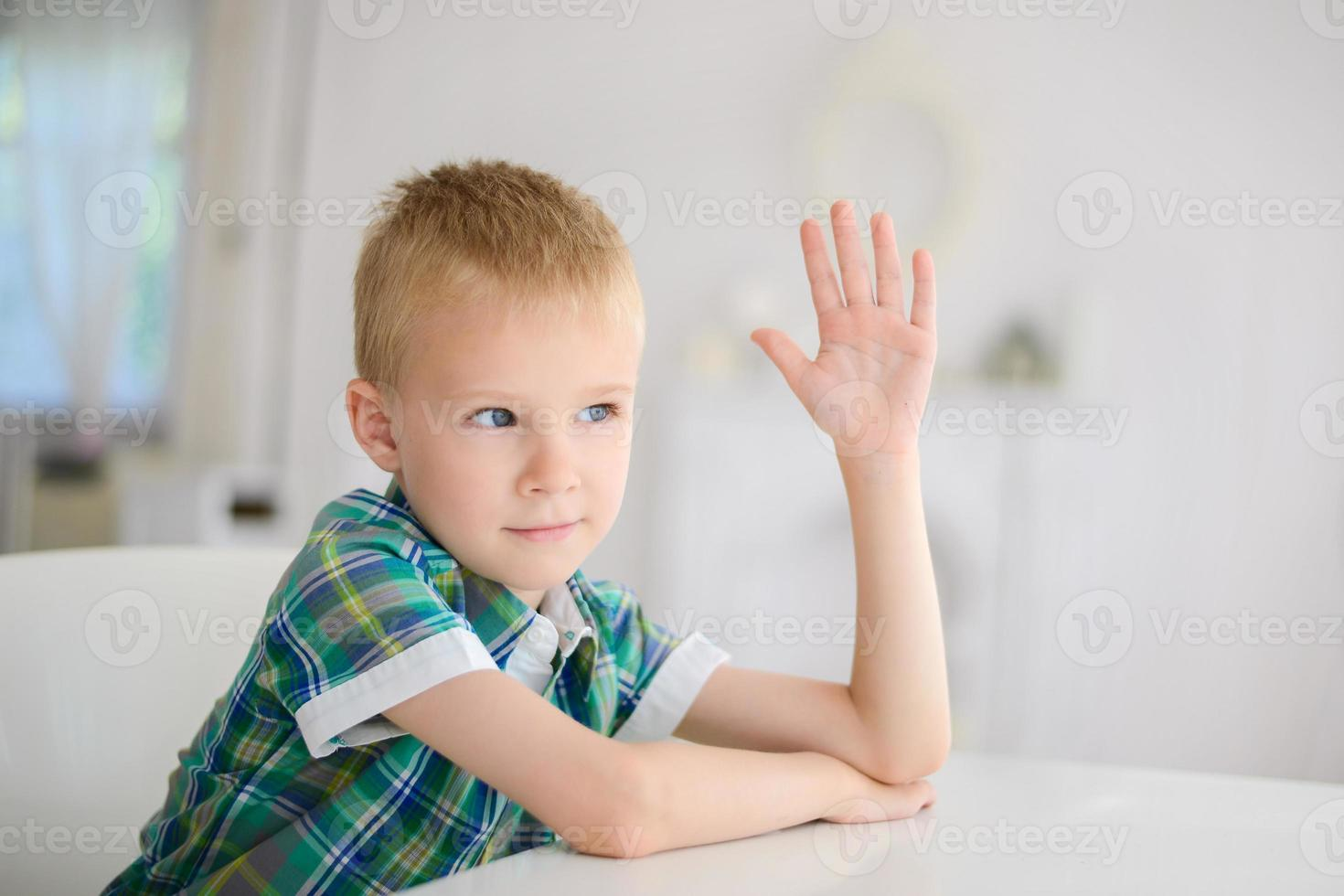 Schoolboy ready to answer question photo