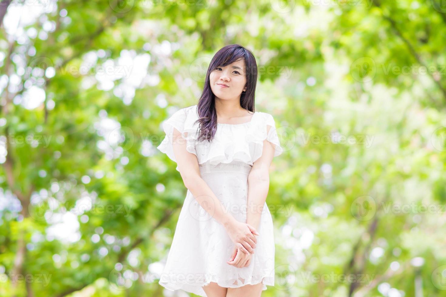 Portrait beautiful asian woman walking in park photo