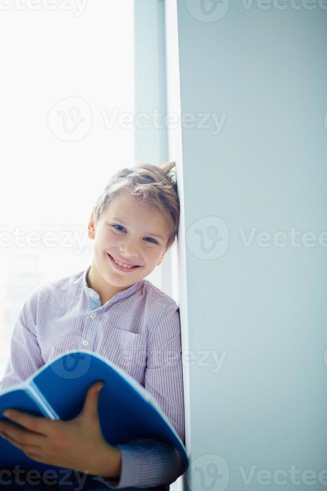 Cheerful schoolboy photo