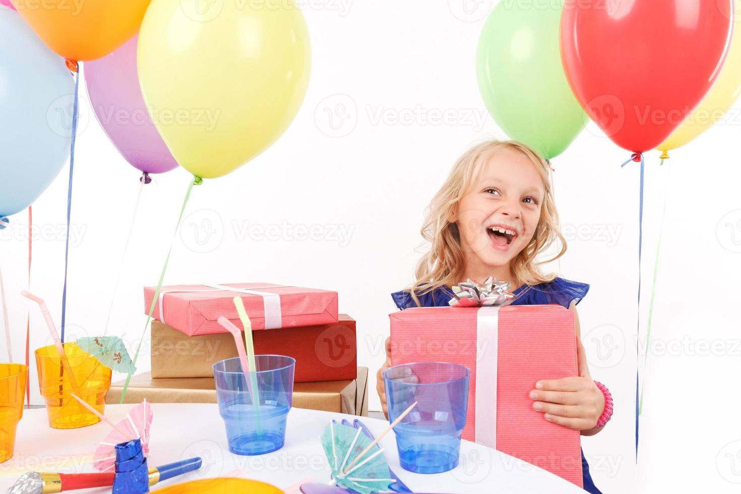 Cheerful girl holding present box photo