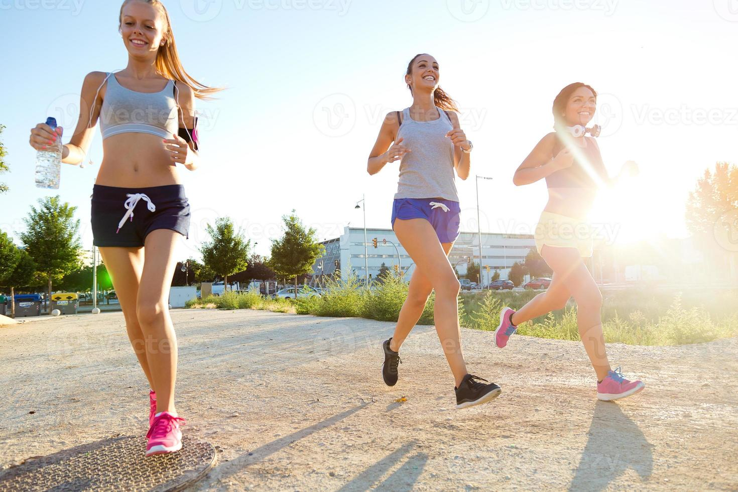 Group of women running in the park. photo