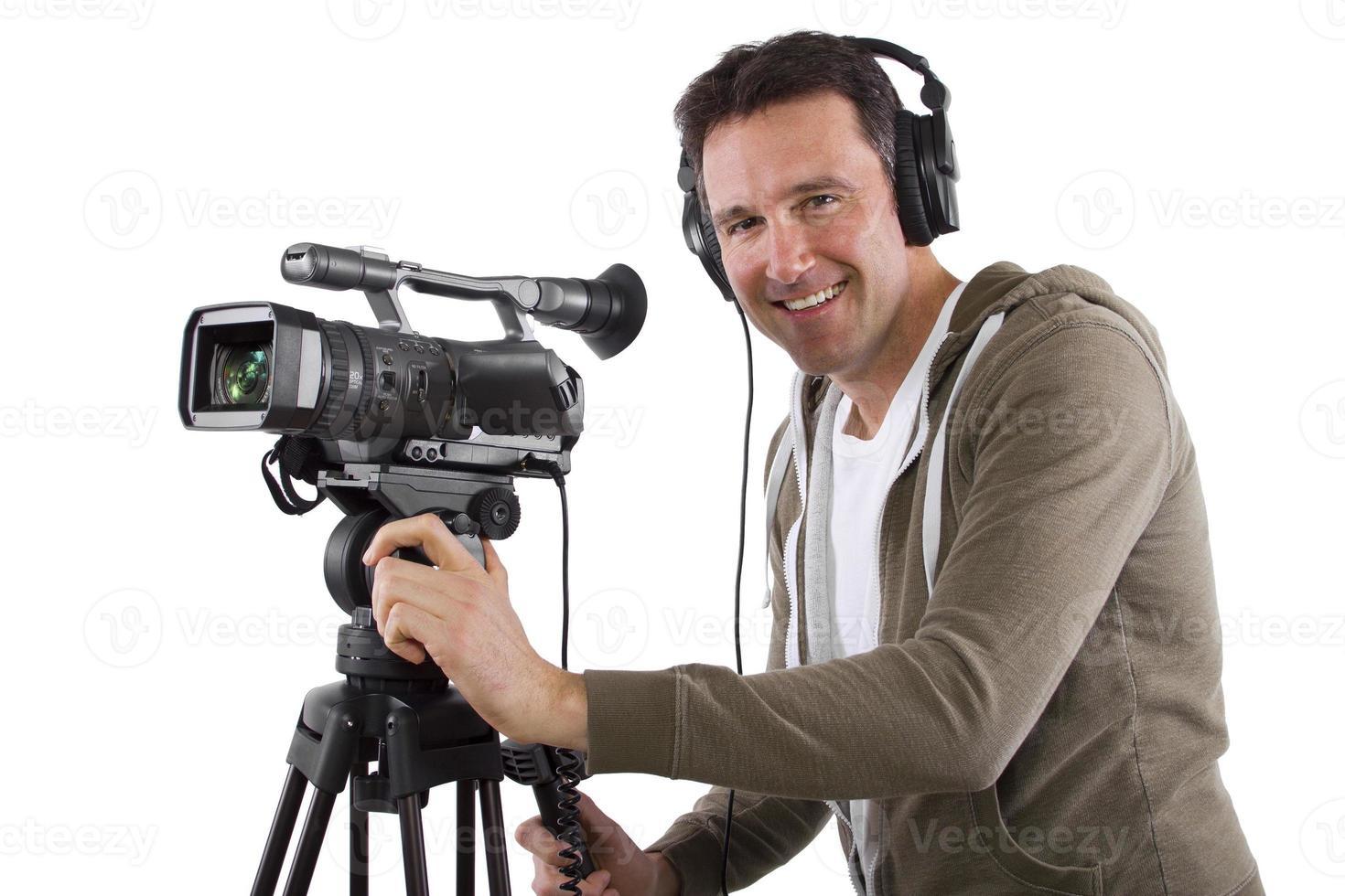 Cheerful video camera operator with tripod photo