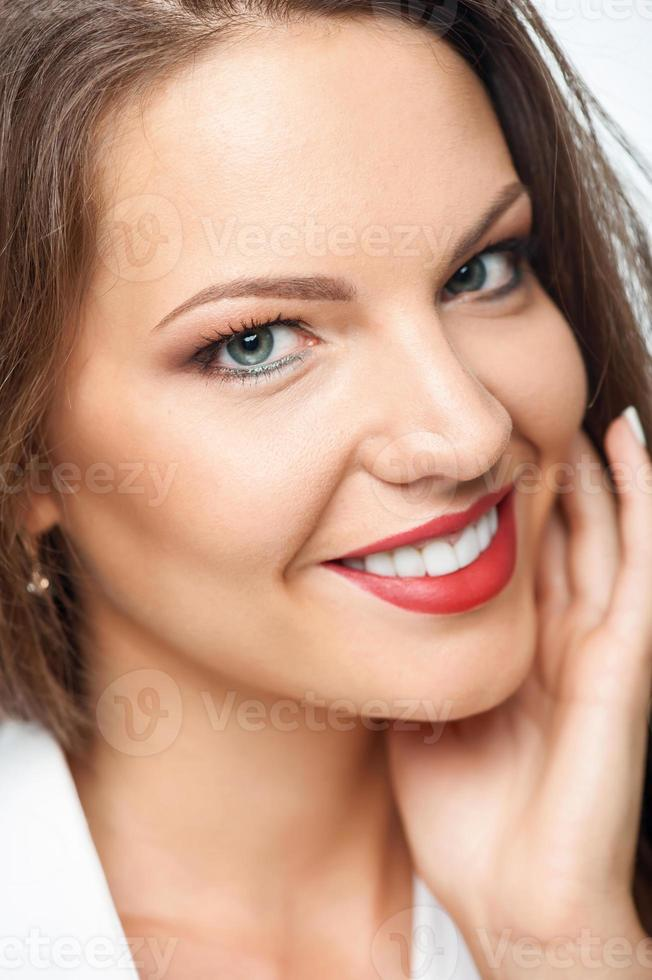 Cheerful young woman is expressing positive emotions photo