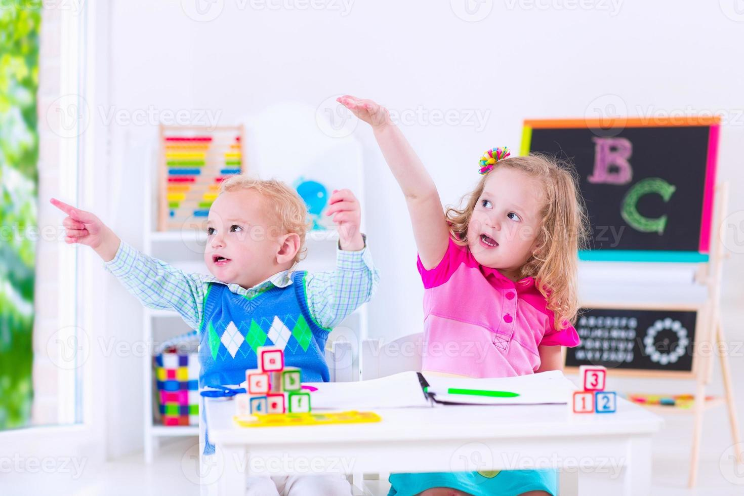 Adorable kids at preschool painting photo