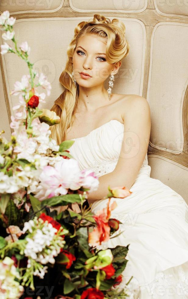 beauty young bride alone in luxury vintage interior with a photo