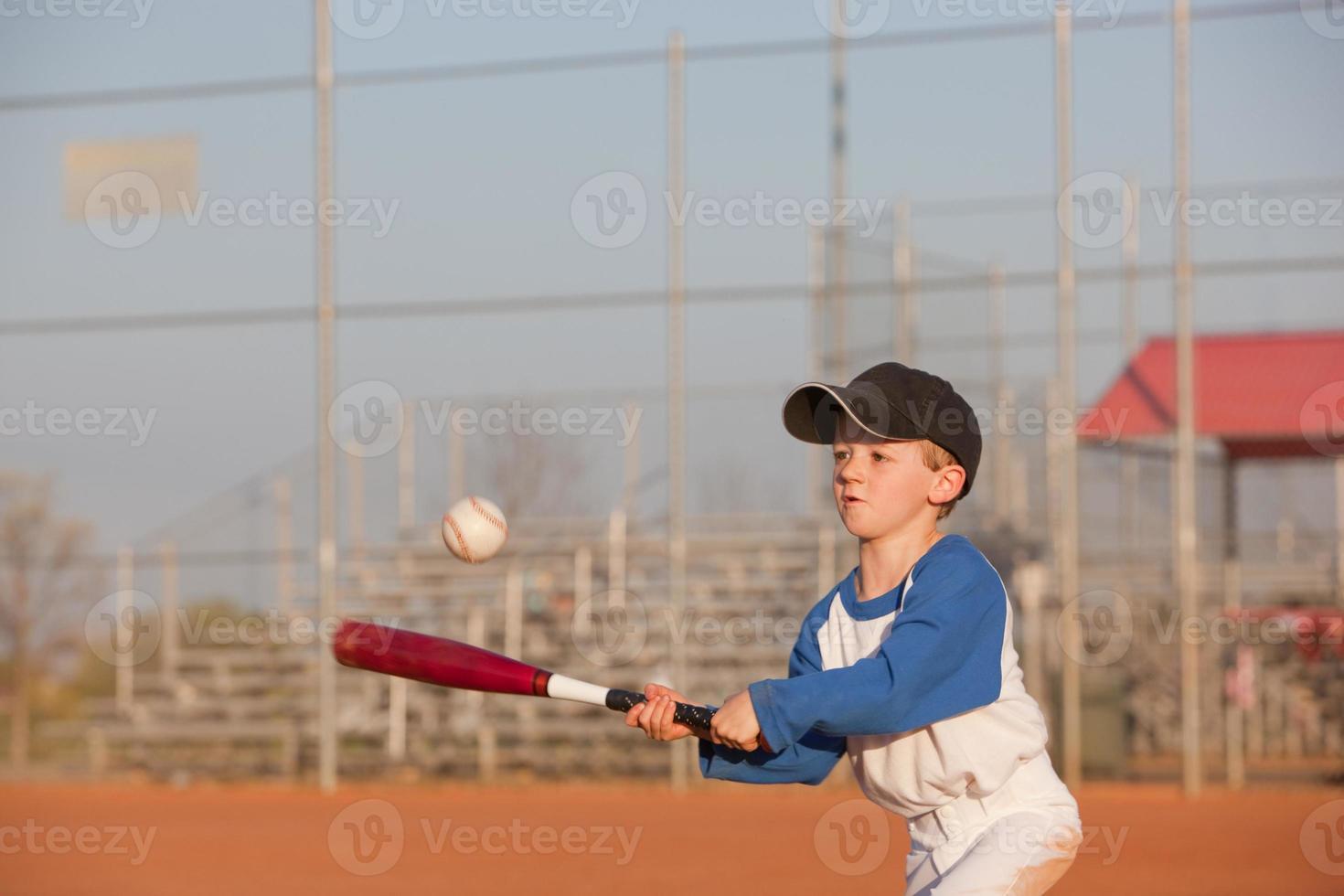 Determined Little Baseball Hitter photo
