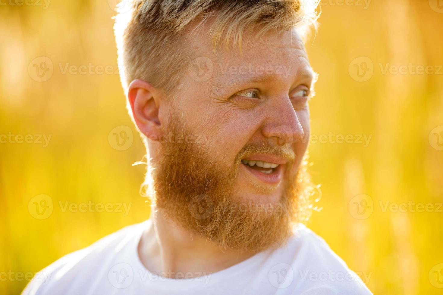 Cheerful blond bearded man in т-shirt photo