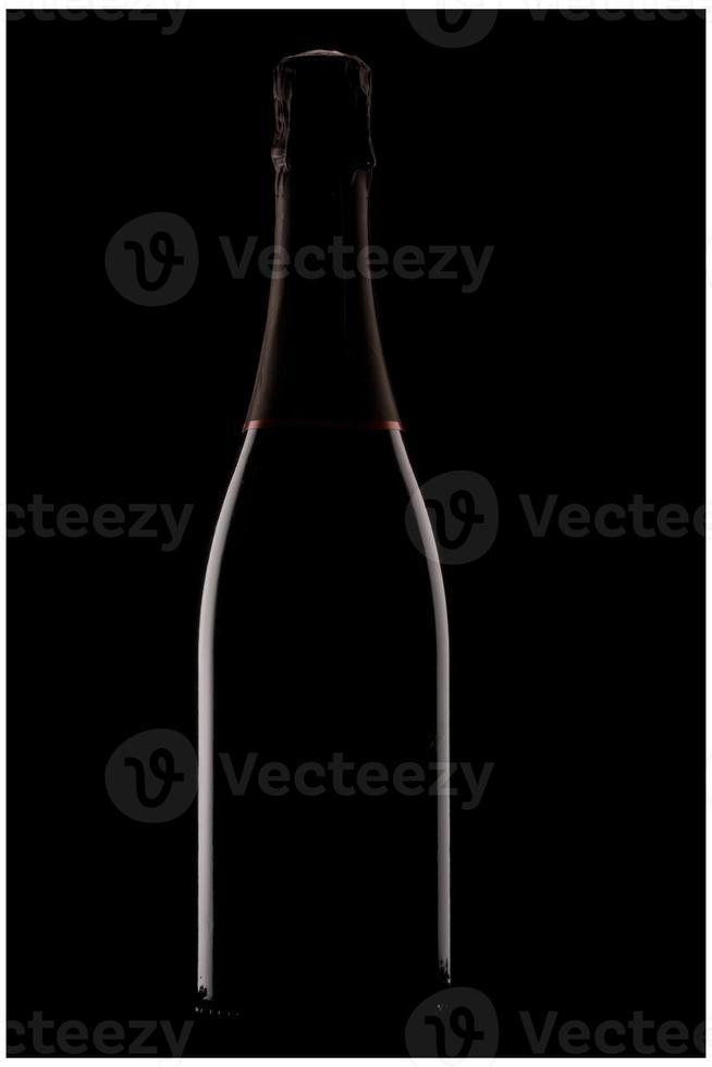 Backlit champagne bottle photo