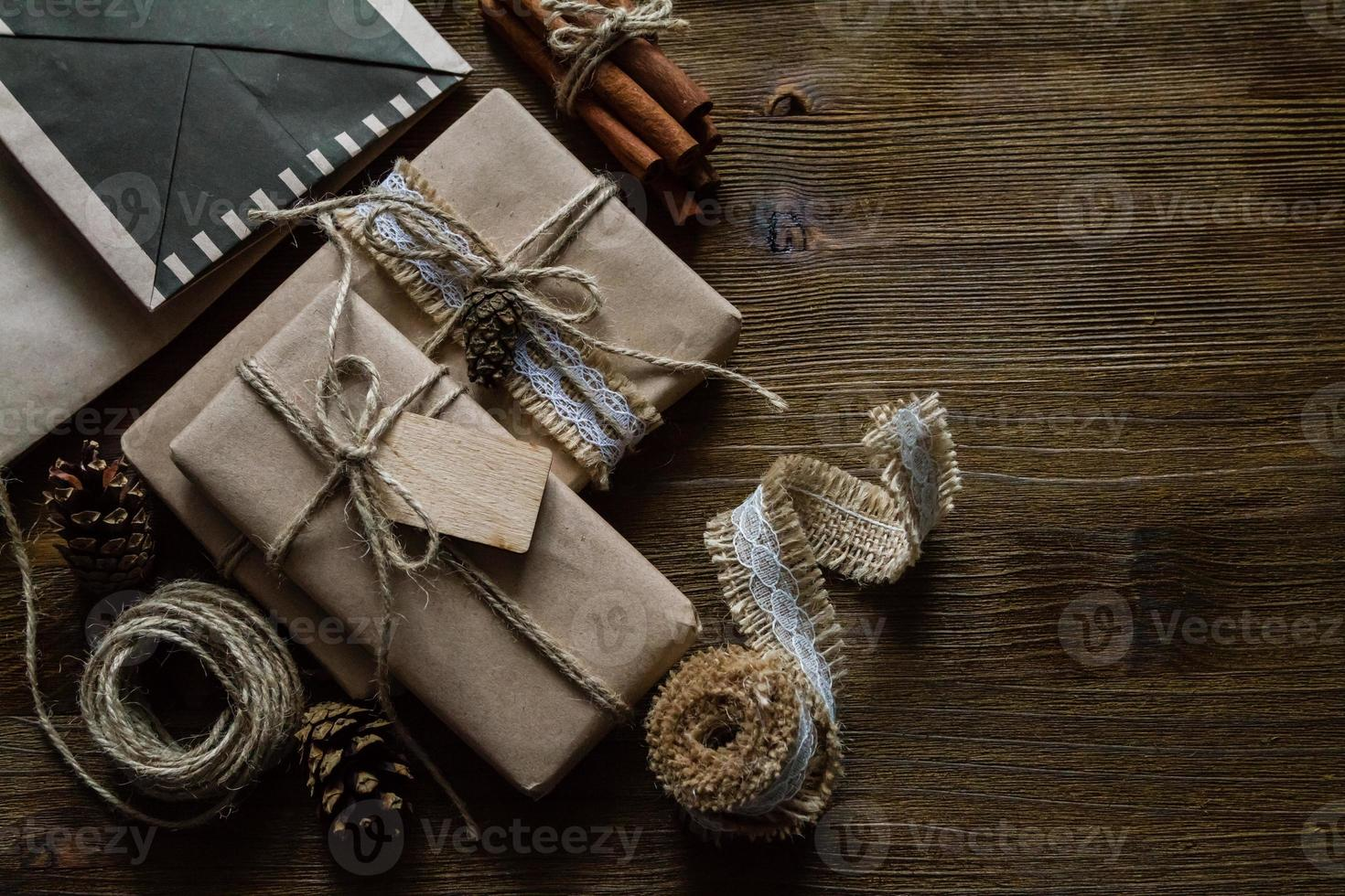 Presents in rustic wrap, wood background photo