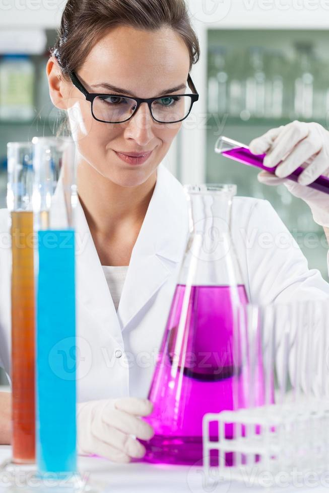 Woman doing experiment in laboratory photo