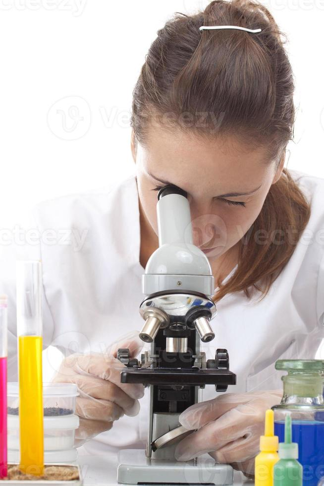 Woman working with a microscope photo