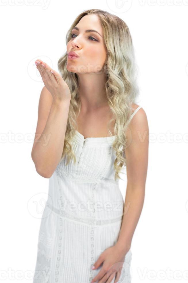 Cheerful  blonde sending a kiss photo