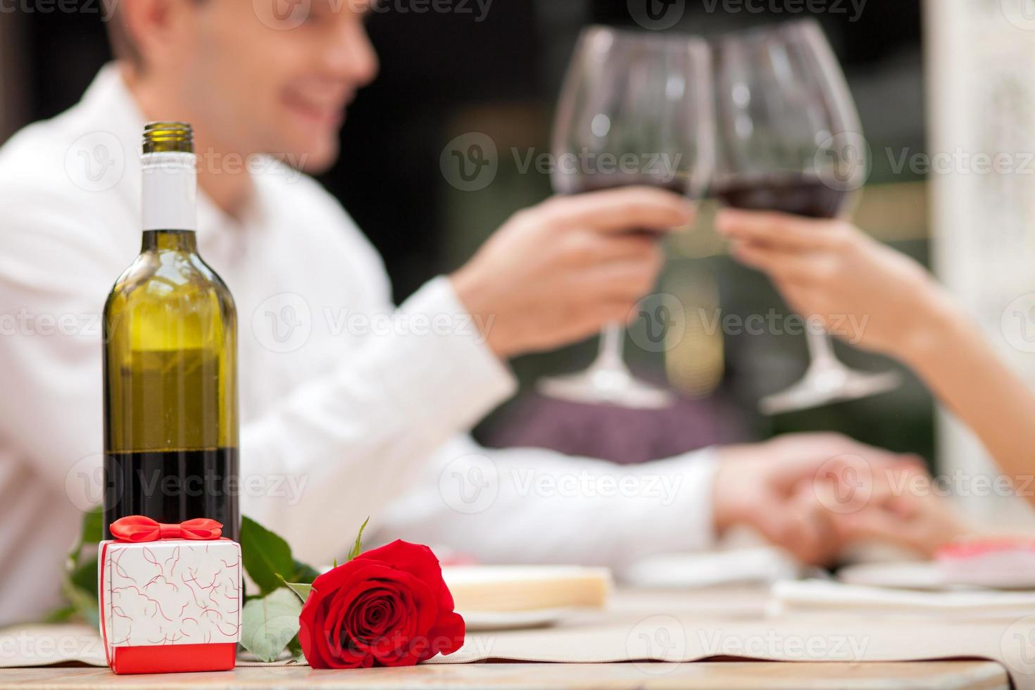 Cheerful loving couple is celebrating in cafe photo