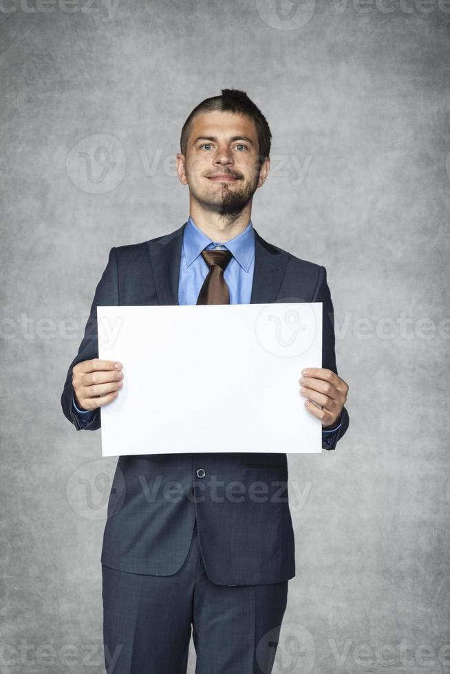 smiling businessman says, copy space for you photo