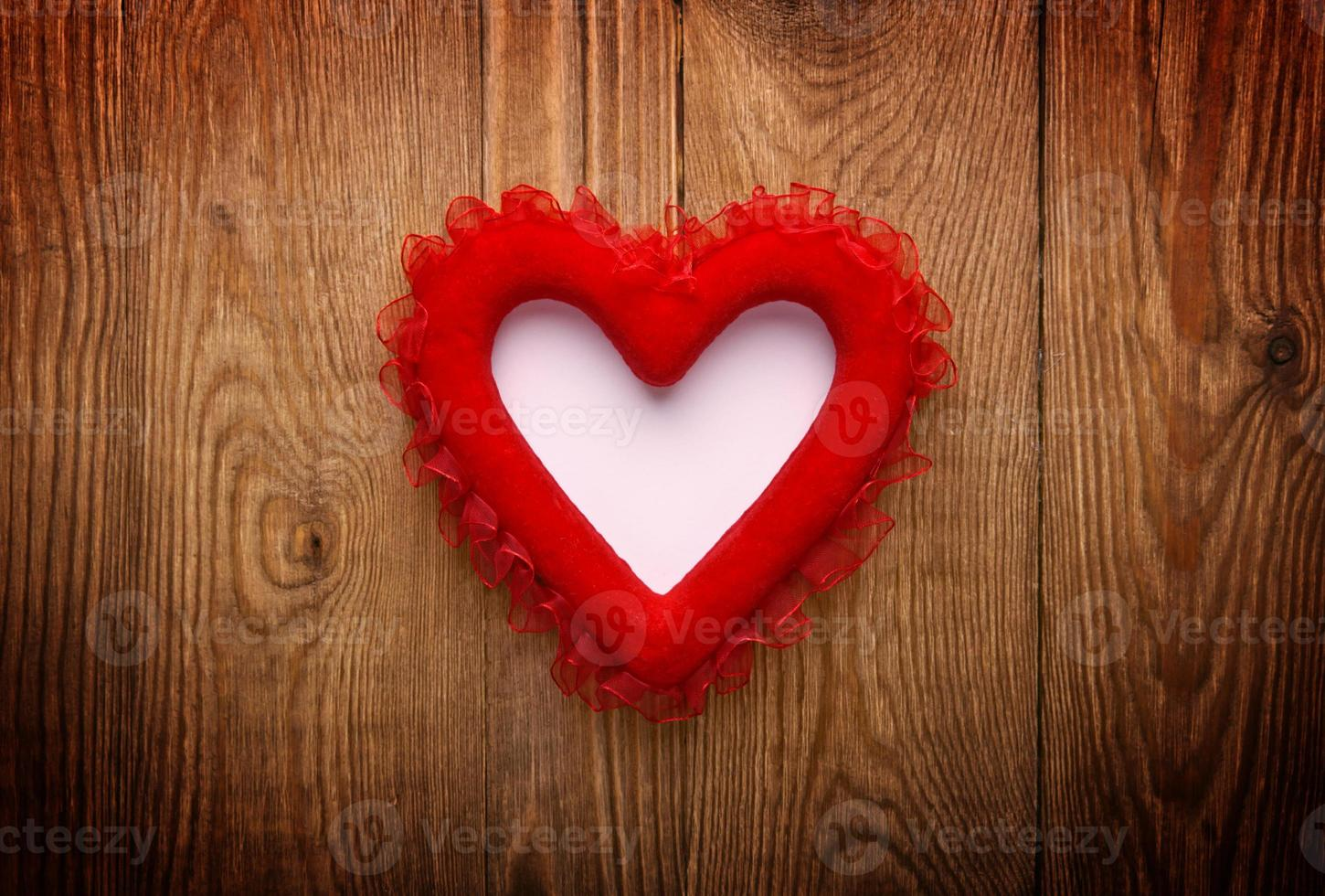 red heart on wood with copy space photo