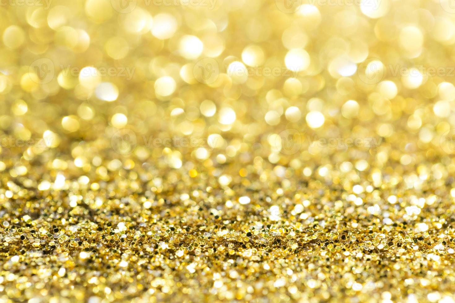 Gold abstract glitter background with copy space photo
