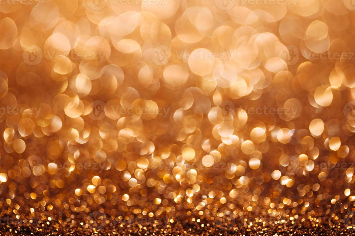 Gold defocused glitter background with copy space photo