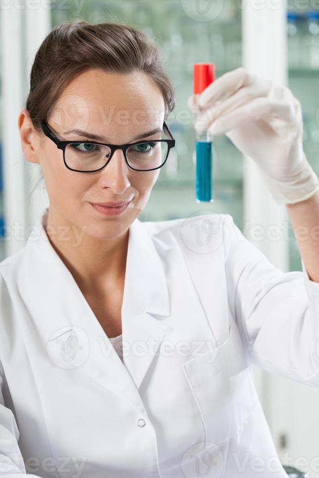 Chemist watching test tube photo