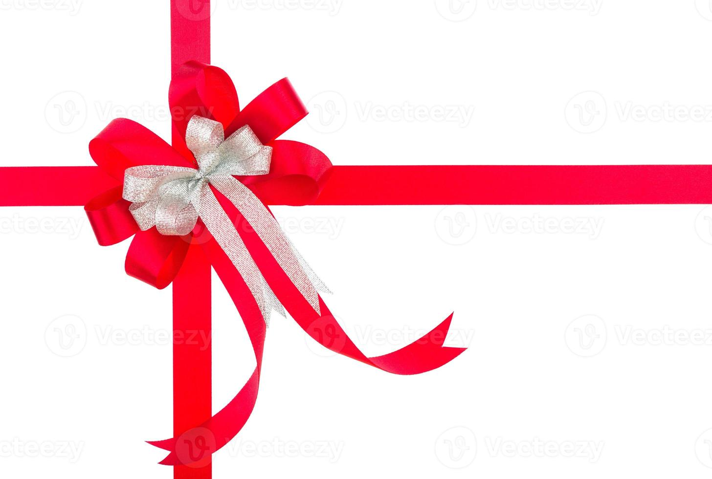 Shiny red ribbon on white background with copy space. photo