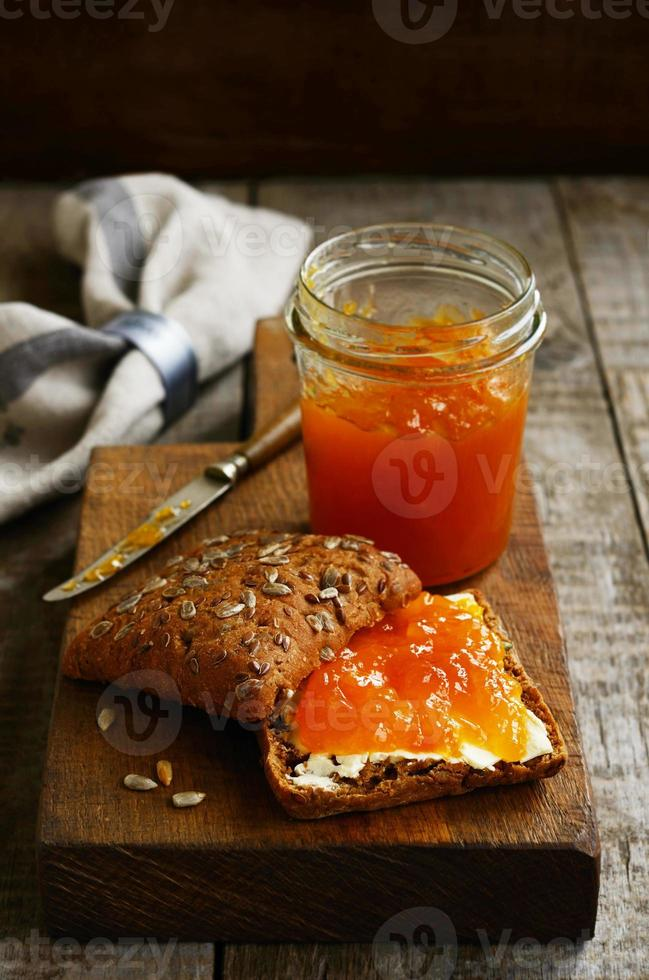 Apricot jam sandwich with copy space on dark background photo