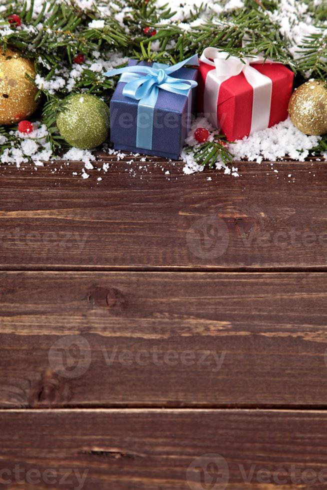 Christmas decorations on wooden board background with copy space photo