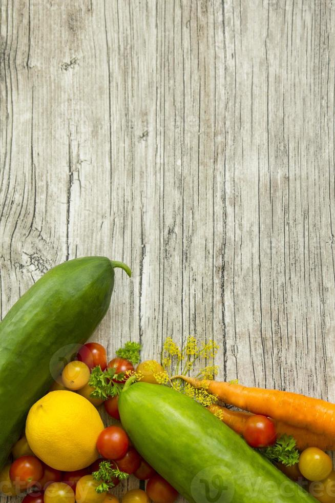 Beautiful fresh vegetables on rustic wooden table with copy space photo