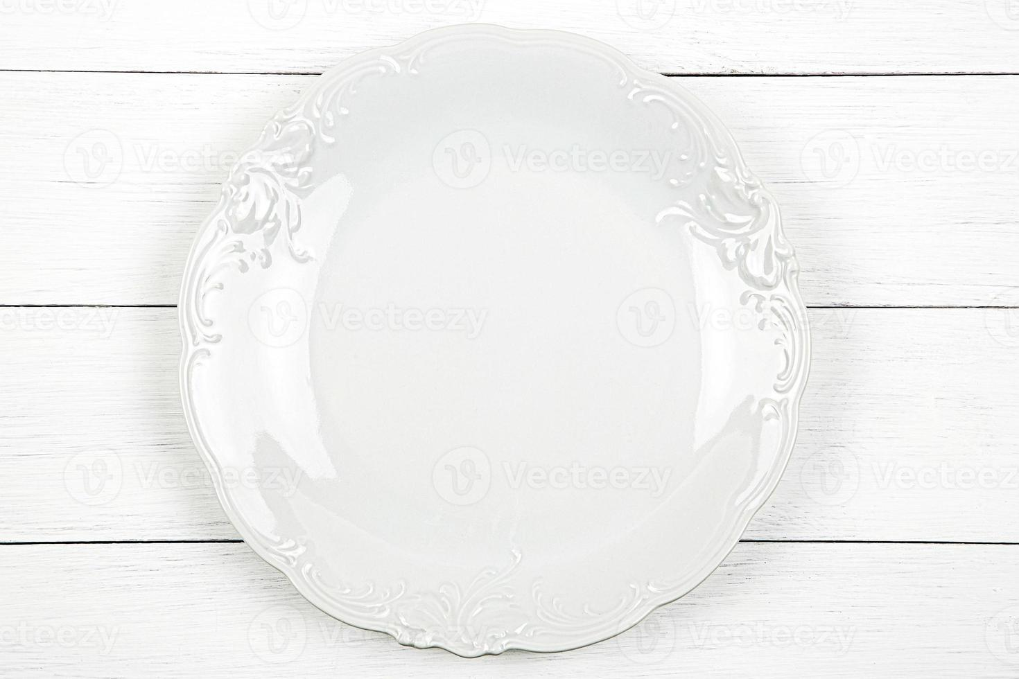 Empty plate on a wooden background photo