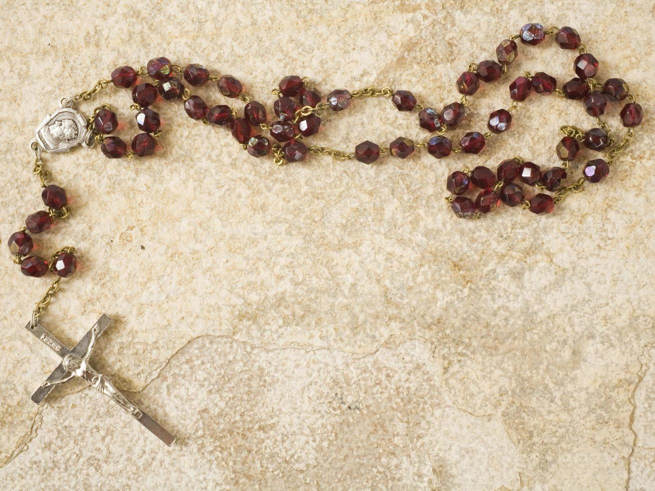 Rosary beads on stone with copy space photo