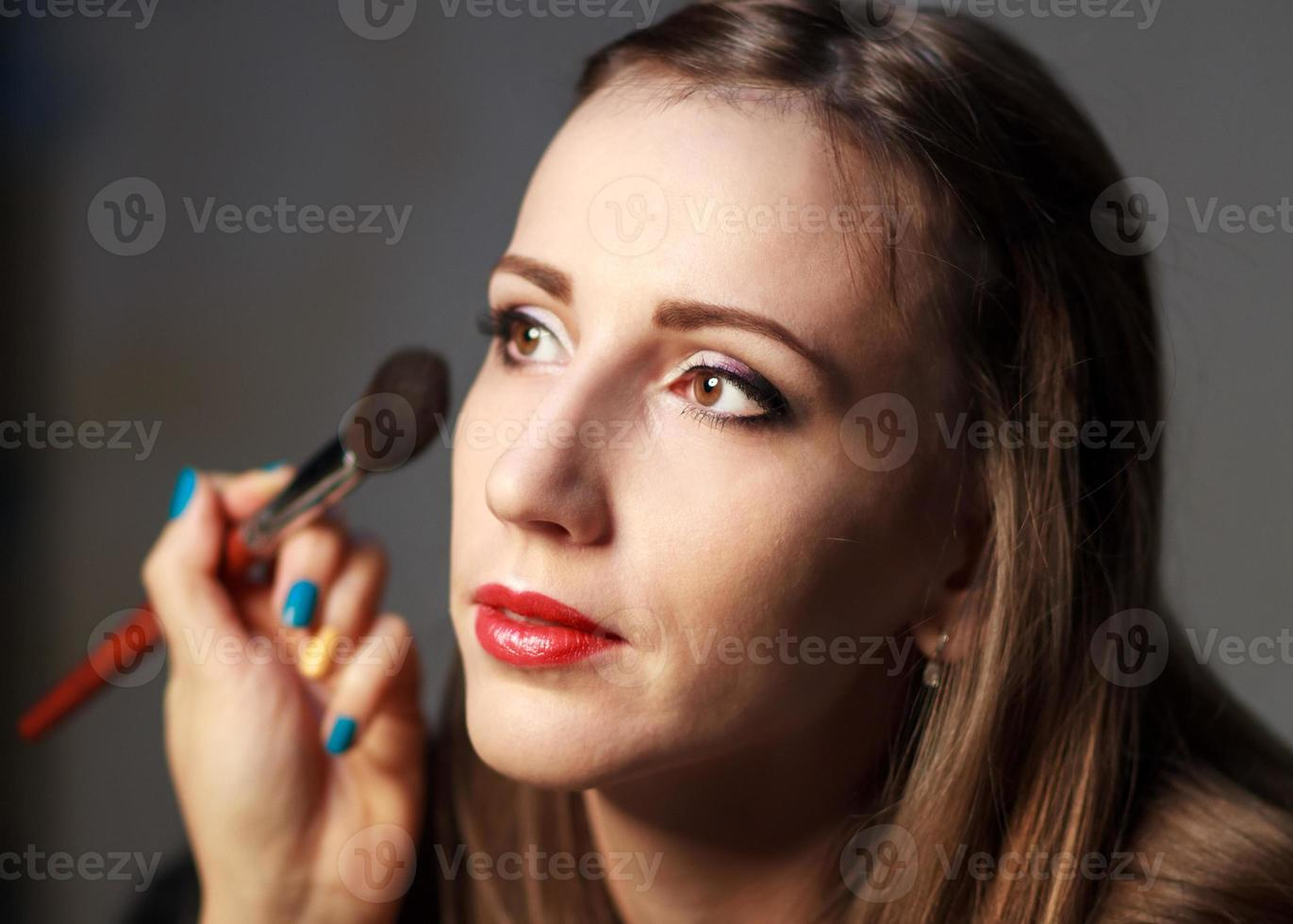 Professional makeup in studio. photo