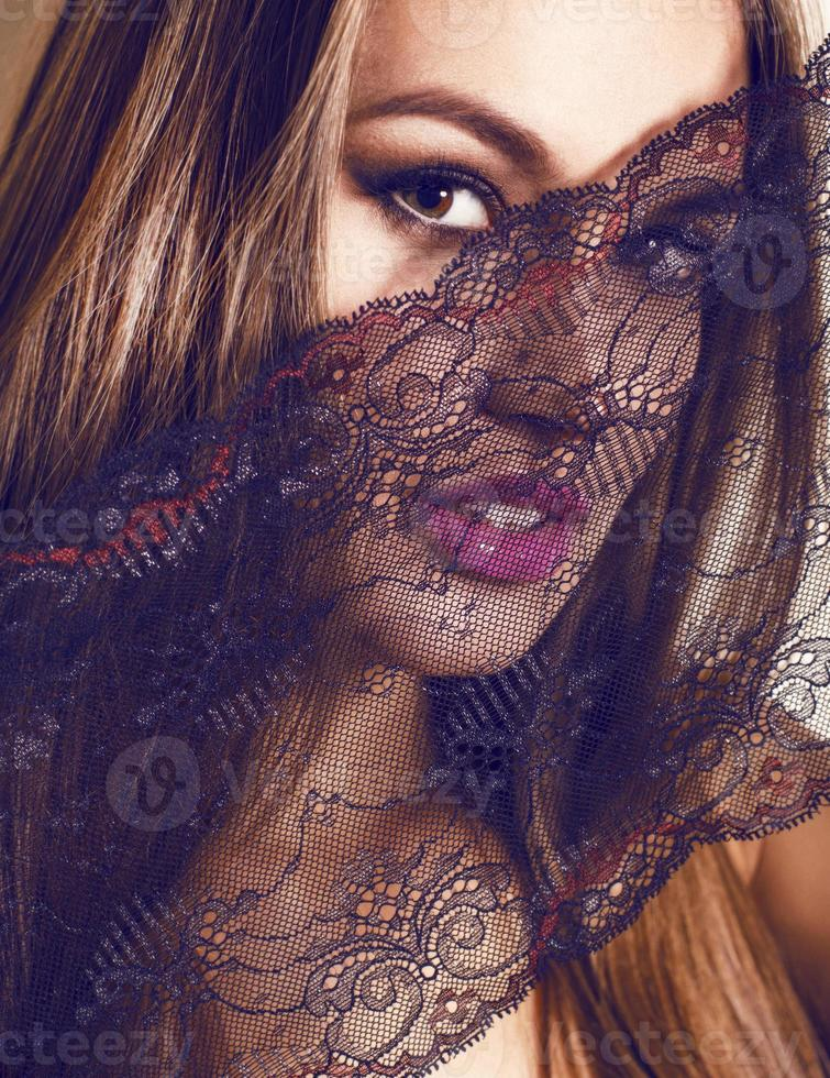 portrait of beautiful girl with lace photo