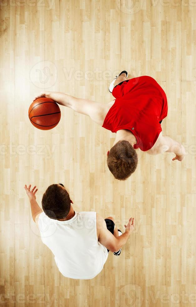 Two players playing basketball photo