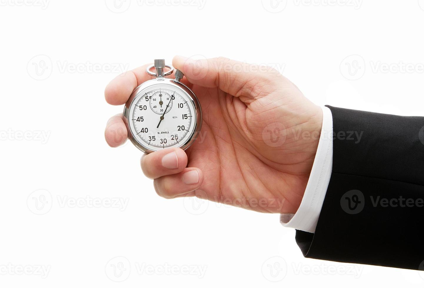 Stopwatch in human hand photo