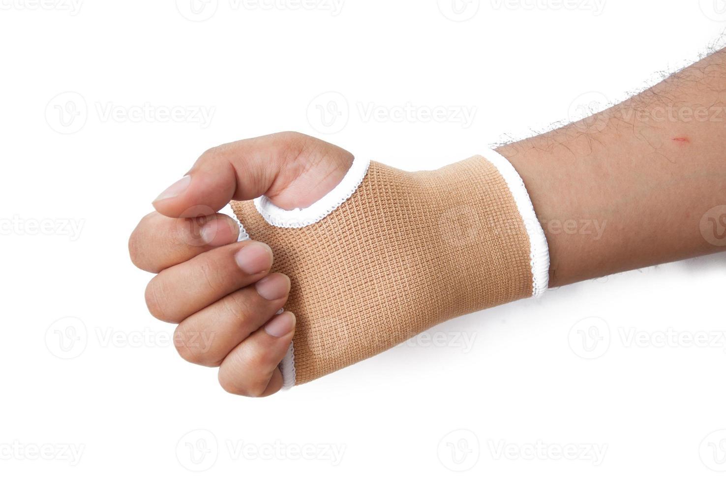 férula de mano de primer plano para el tratamiento de hueso roto aislado en blanco foto