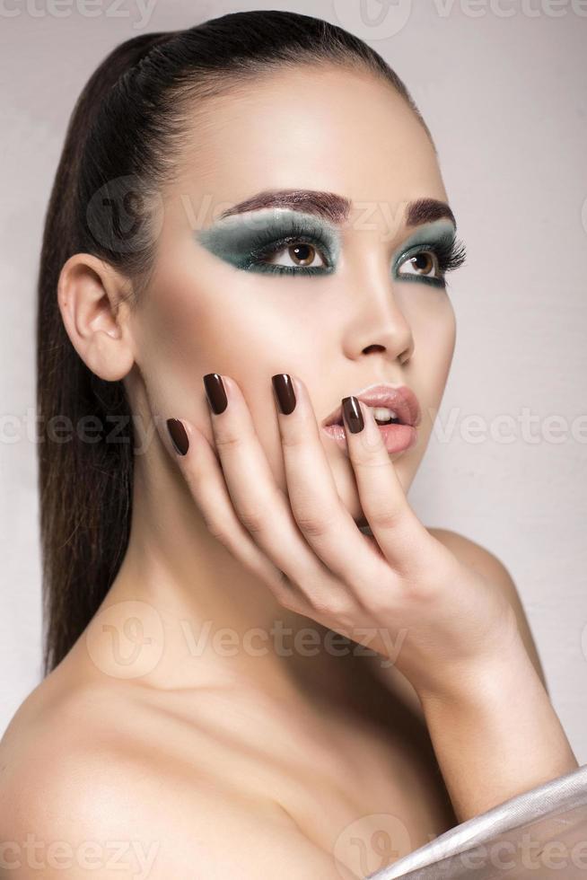 beautiful girl with green smokey eyes make up photo