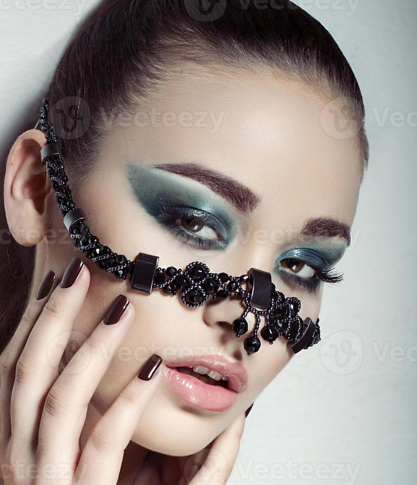 portrait of beautiful girl with accessory photo