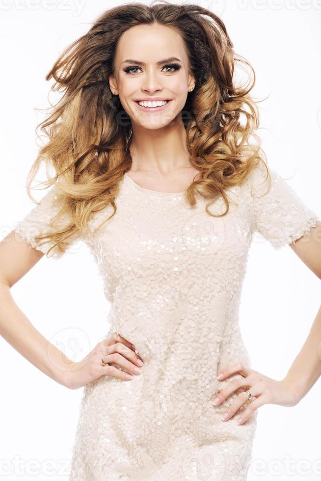 Young joyful lady with pretty smile photo