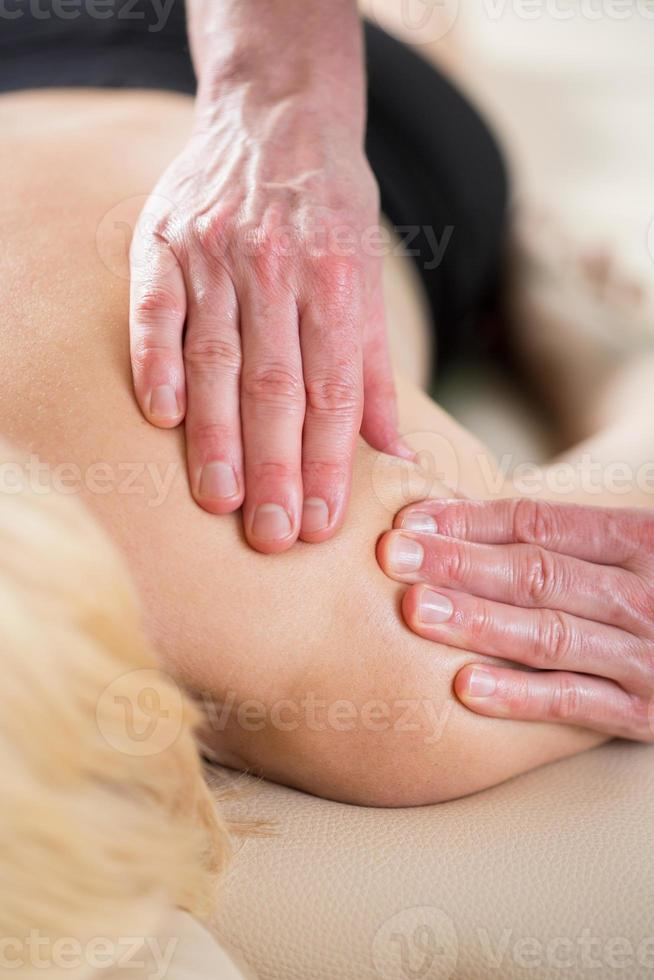 Physiotherapist treating soft tissues photo