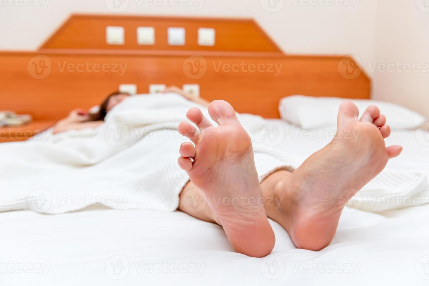 female feet close up stretch themselves upon waking photo