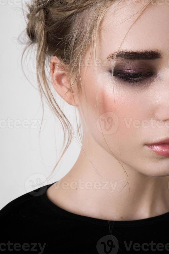 Half face of beauty model with smoky eyes photo