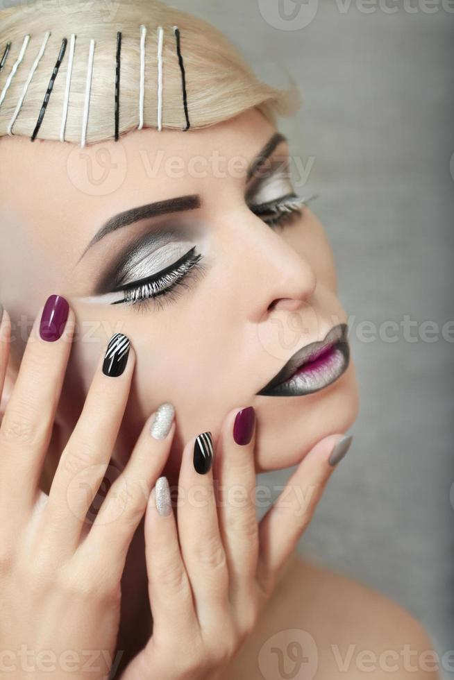 Makeup and manicure in gray. photo
